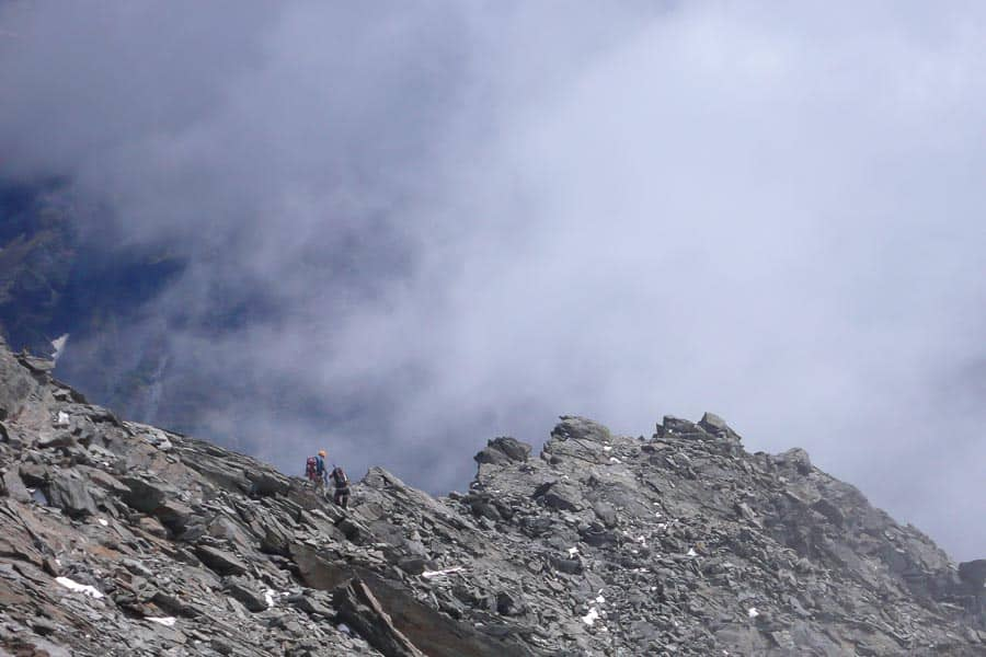 New Zealand Mountain Guide and Climber Descending the North West Ridge of Mt Aspiring