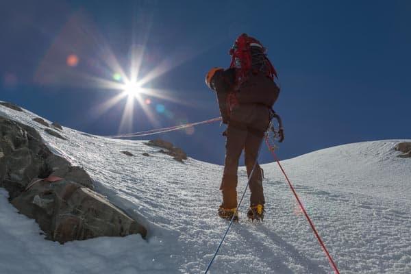 Climber abseiling Mt Dixon East Ridge